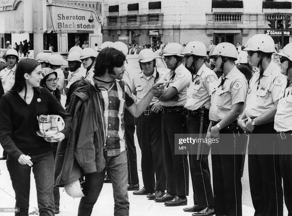A group of hippies taunting policemen during the trial of the Chicago Seven, a group of radicals arrested during the protests against the Vietnam war at the Democratic National Convention.
