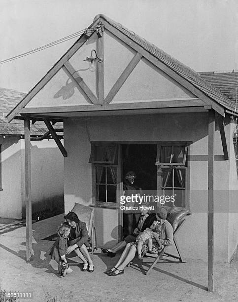 A group of holidaymakers outside their cabin at a Butlin's holiday camp in Filey North Yorkshire 1946 Original Publication Picture Post 4136 Life In...