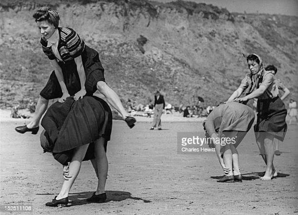 A group of holidaymakers playing leapfrog at a Butlin's holiday camp in Filey North Yorkshire 1946 Original Publication Picture Post 4136 Life In A...