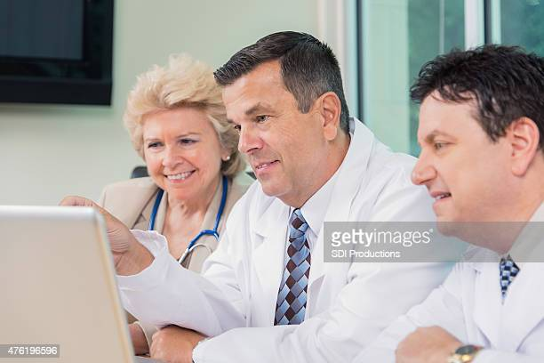 Group of hospital doctors meeting to diagnose patient