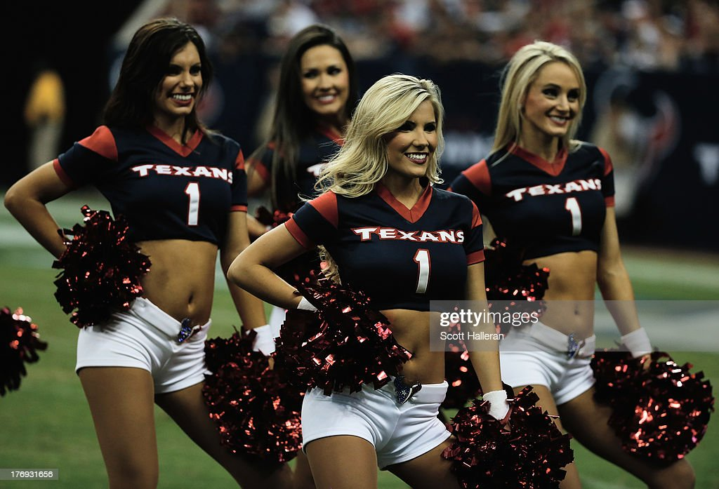 A group of Houston Texans cheerleaders perform in the second half of the preseason game against the Miami Dolphins at Reliant Stadium on August 17, 2013 in Houston, Texas.