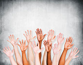 Group of Human Arms Raised with Concrete wall