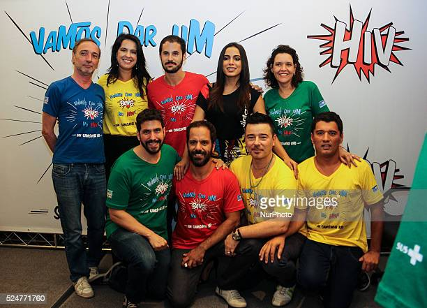 Group of human rights activists and AIDScombat activists pose together at the singer Anitta during launch of the campaign for the prevention of...