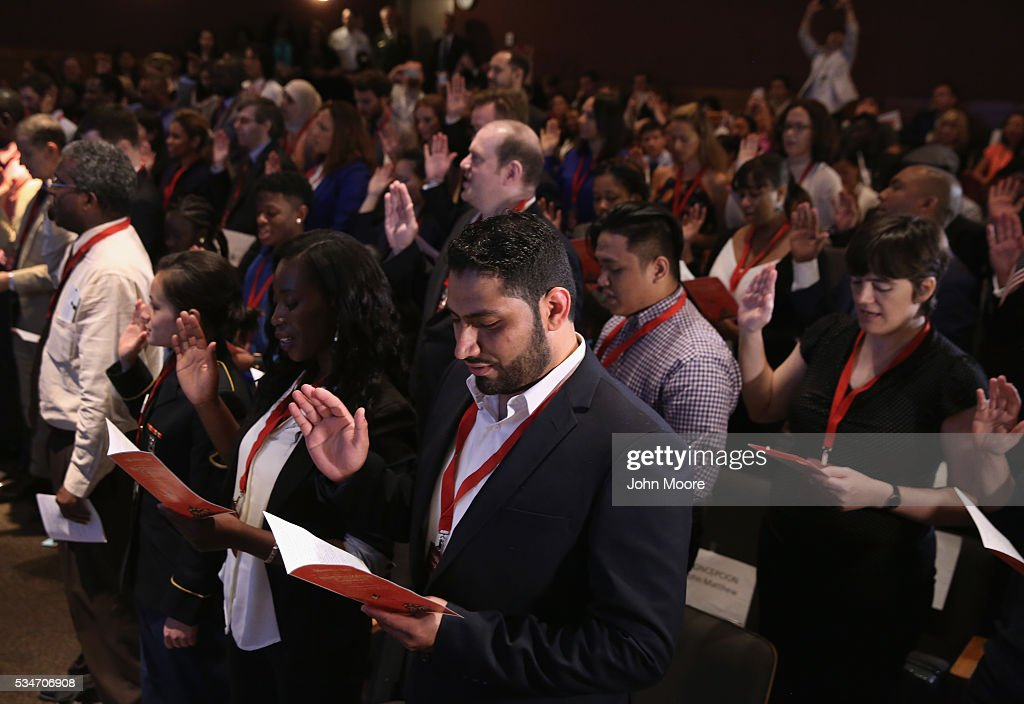 A group of immigrants become new American citizens during a naturalization ceremony on Ellis Island on May 27, 2016 in New York City. U.S. Secretary of Homeland Security Jeh Johnson administered the oath of citizenship to immigrants from 39 countries on the historic island in New York Harbor where millions of immigrants first arrived to America. The ceremony, held by U.S. Citizenship and Immigration Services (USCIS), was held in honor of Memorial Day and is one of 100 naturalization ceremonies held in U.S. national parks in celebration of the National Park Service's 100th anniversary.