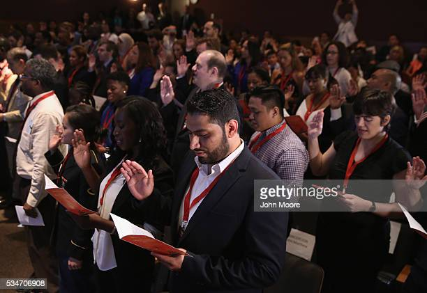 A group of immigrants become new American citizens during a naturalization ceremony on Ellis Island on May 27 2016 in New York City US Secretary of...