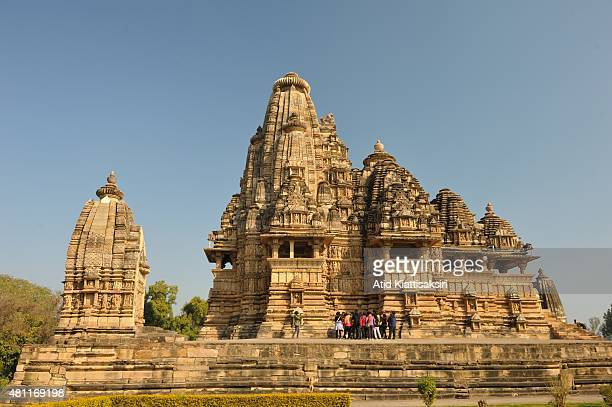A group of Indian tourists are sightseeing the Vishwanath Temple one of the Khajuraho group of monuments a part of UNESCO World Heritage Sites at...