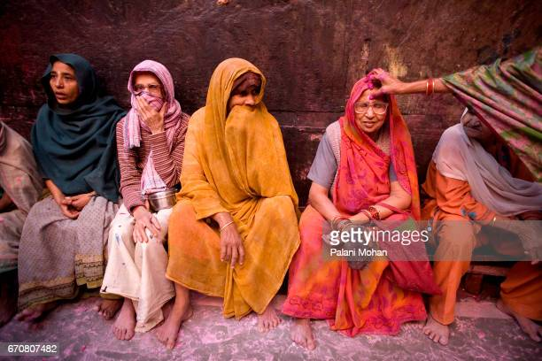 A group of Indian women wait inside the side the Banke Bihari Temple to take part in the Holi celebrations March 22 2008 in Vrindavan India Holi is...