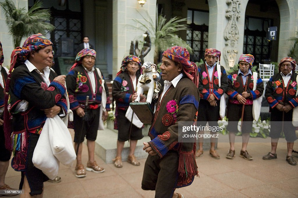 A group of indigenous people from Chichicastenango municipality take part in a ceremony to commemorate the 16th anniversary of the country's civil war peace agreements at the National Palace of Culture in Guatemala City, on December 29, 2012. The agreements were signed between the government of former president Alvaro Arzu and the leftist guerrillas, Guatemalan National Revolutionary Unity (URNG) in 1996, putting an end to 36 years of a war that left 200,000 people dead or missing in Guatemala, according to the United Nations. AFP PHOTO/Johan ORDONEZ
