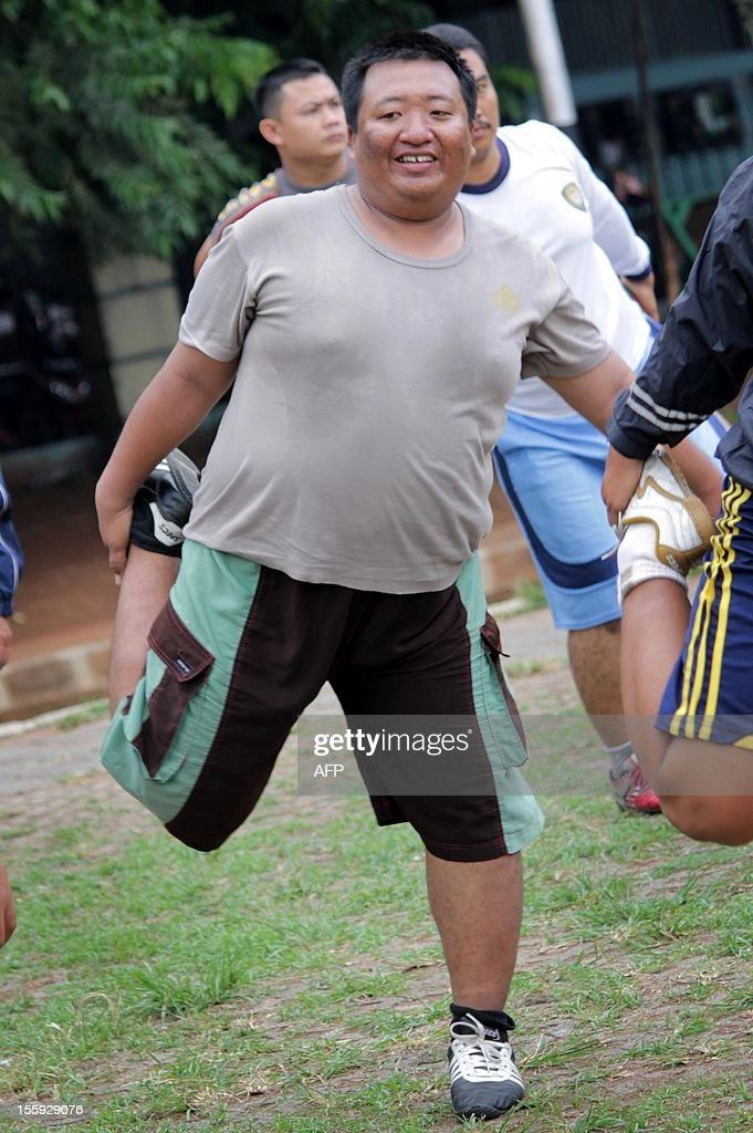 A group of Indonesian police officers take part in a physical exercise workout in Tangerang city in the outskirts of Jakarta on November 9, 2012. Overweight policemen in Tangerang have been ordered to join an exercise programme as many of them are currently too slow to catch fleeing criminals.