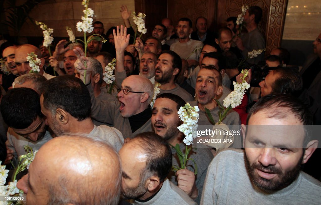 A group of Iranians who had been held hostage by Syrian rebels since early August arrive at a hotel in Damascus after being freed in a prisoner swap on January 9, 2013. A total of 48 Iranians were released in the unprecedented exchange for 2,130 prisoners detained by President Bashar al-Assad's regime, according to several sources.