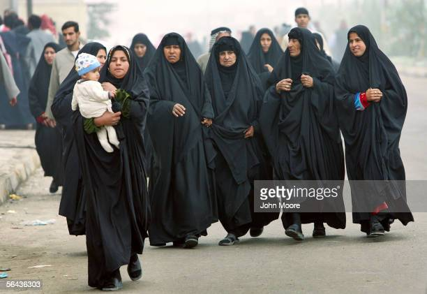A group of Iraqi women walk towards a polling station to vote in parliamentary elections on December 15 2005 in Az Azubayr Iraq High numbers of...
