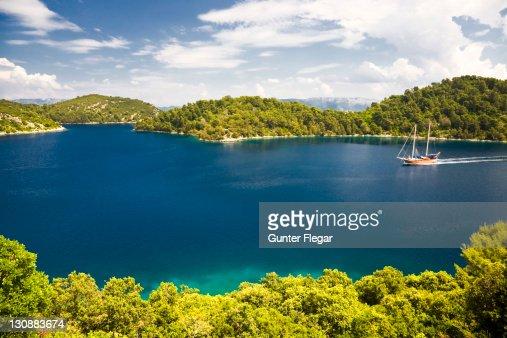 Group of islands with a sailing boat, Mljet National Park, Mljet Island, Dubrovnik-Neretva, Dalmatia, Croatia, Europe : Stock Photo