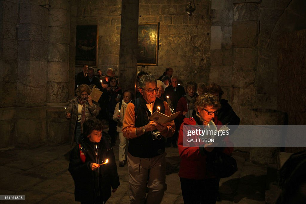 A group of Italian pilgrims pray on February 11, 2013 at the Church of the Holy Sepulcher in Jerusalem's Old City. Pope Benedict XVI improved ties between Judaism and Christianity which helped reduced anti-Semitism around the world, the Ashkenazi Chief Rabbi of Israel said following the pontiff's shock resignation. AFP PHOTO/GALI TIBBON