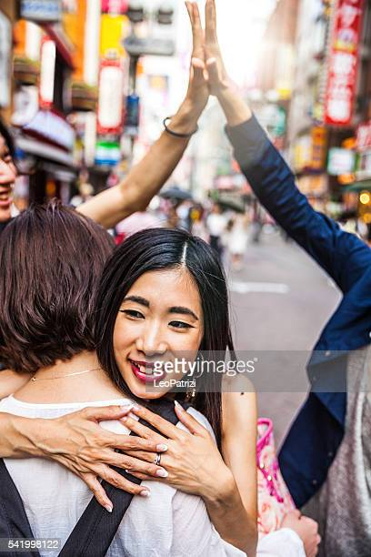 Group of Japanese friends meet up in Tokyo Shibuya