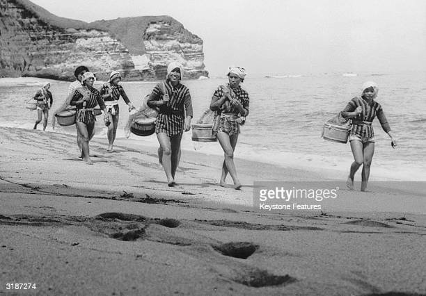 A group of Japanese skin divers or 'Amas' prepare for a day's work near the small fishing village of Onjuku in the Chiba prefecture of Japan August...