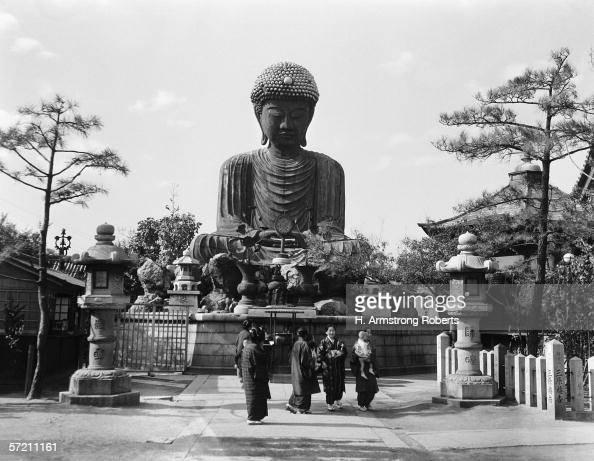 Group of Japanese woman at base of Daibutsu Buddha statue near Kobe Hyogo