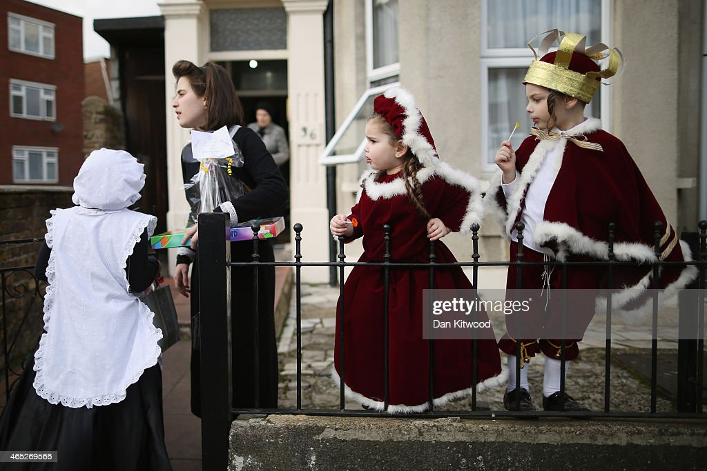A group of Jewish children in fancy dress stand outside their home during the Jewish holiday of Purim on March 5 2015 in London England The annual...