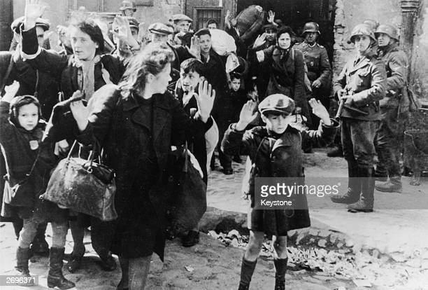 Jews from the Warsaw ghetto surrender to German soldiers after the Warsaw Ghetto Uprising of AprilMay 1943 On the right is SS Josef Blösche