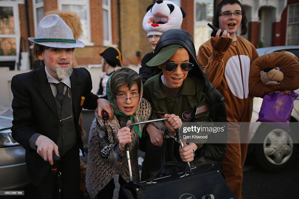 A group of Jewish girls in fancy dress walk through the streets collecting money for their school during the Jewish holiday of Purim on March 5 2015...