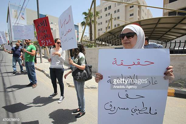 A group of Jordanians gathering outside the Energy Ministry stage a protest against the projected gas deal with Israel in Amman Jordan on April 21...