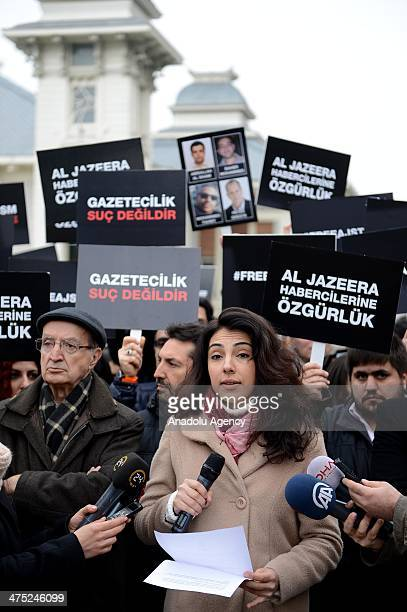 A group of journalists gathers outside the Egyptian Embassy in Istanbul to speak to the media over the release of Al Jazeera Arabic network...