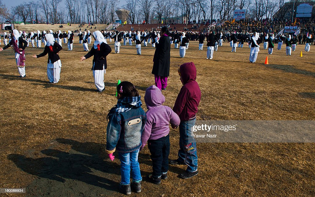 A group of Kashmiri children watch the main function at the Bakshi stadium during India's Republic Day celebrations on January 26, 2013 in Srinagar, the summer capital of Indian Administered Kashmir. All businesses, schools and shops were closed and traffic remained off the roads following a strike call given by Kashmiri separatist leaders against India's Republic Day celebrations in Kashmir. Meanwhile India deployed large numbers of Indian police and paramilitary forces to prevent any incidents during the official celebrations.