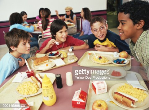 Group of kids having lunch in cafeteria stock photo for Group lunch