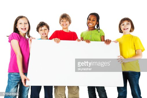 Group of kids holding a big white board. : Stock Photo