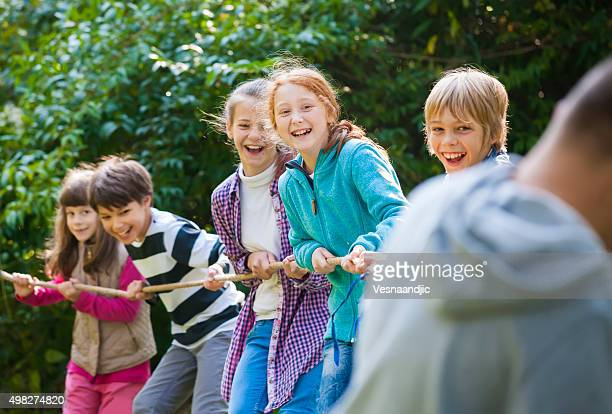 Group of kids in a tug-of-war game