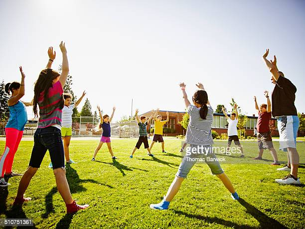 Group of kids in athletics class with coach