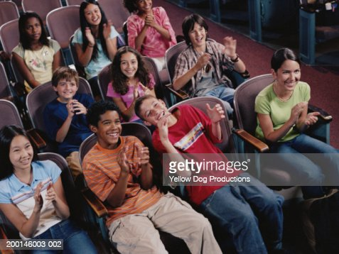 Group of kids (12-14) in chairs laughing, elevated view