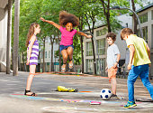 Group of kids elastic ropes together on the street