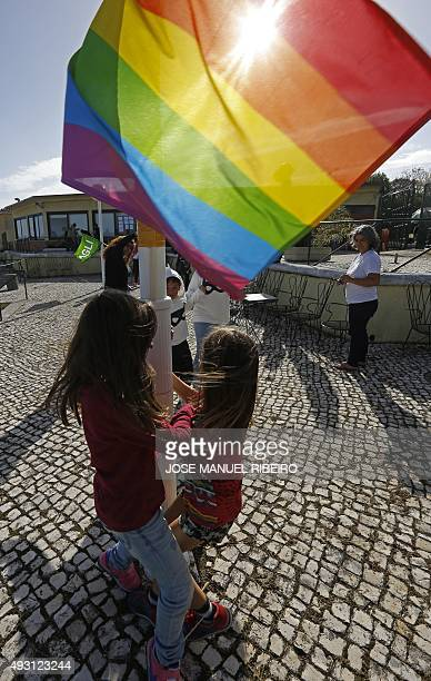 A group of kids play next to a Rainbow flag during the 4th European Meeting of Rainbow Families for gay bisexual and transgender persons in Oeiras on...