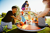 Group of kids playing on merry go round