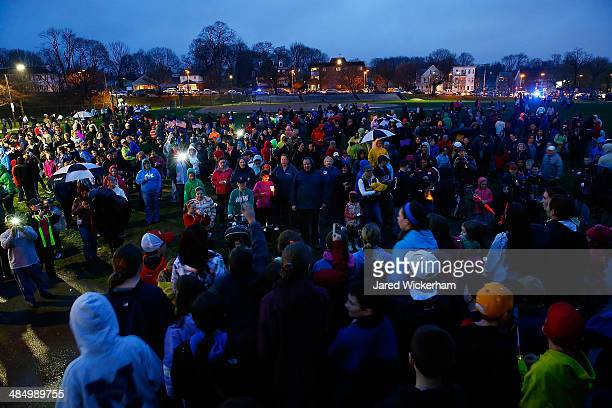 A group of kids sing 'God Bless America' on stage in front of the crowd that gathered in Dorchester for a candlelight vigil for the oneyear...
