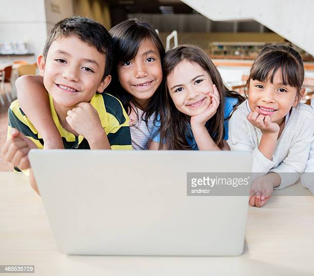 Group of kids with a computer