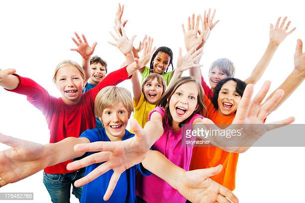 Group of kids with arms up,