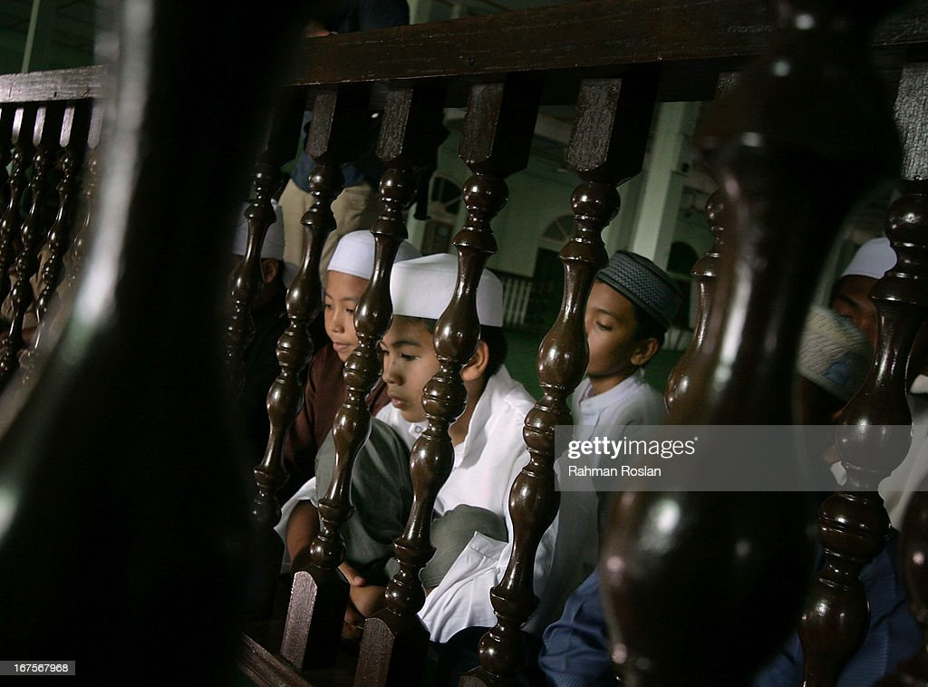 A group of Koran students listen tentatively to Hadi Awang's weekly friday sermon on April 26, 2013 in Rusila, Malaysia. Malaysia's 13th general election will be held on May 5.