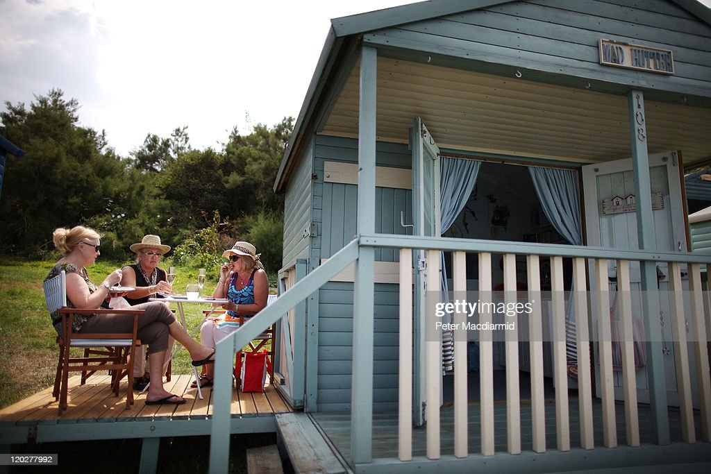 A group of ladies enjoy lunch next to their beach hut on August 3, 2011 in Whitstable, England. Parts of southern England are experiencing high summer temperatures.