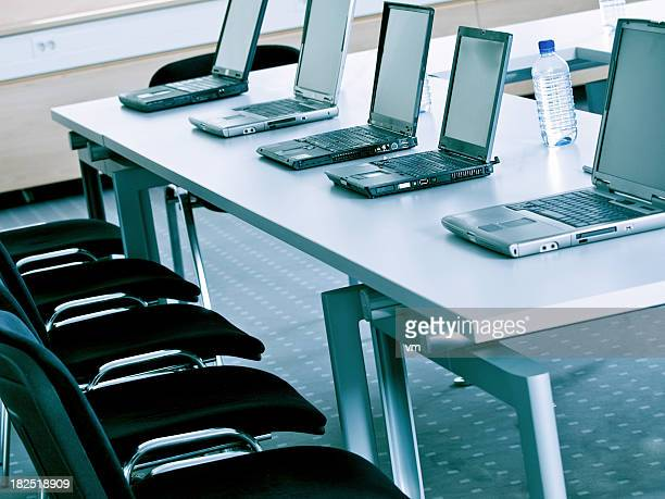 Group of laptops on table