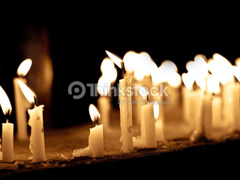 Group Of Lighting Candles In Black Background Showing Hope Faith