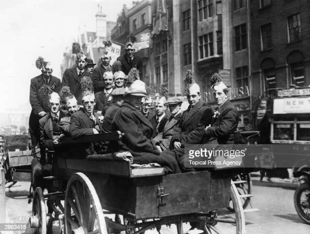 A group of Liverpool supporters on their way to Crystal Palace in the back of a horsedrawn bus for the FA Cup Final against Burnley
