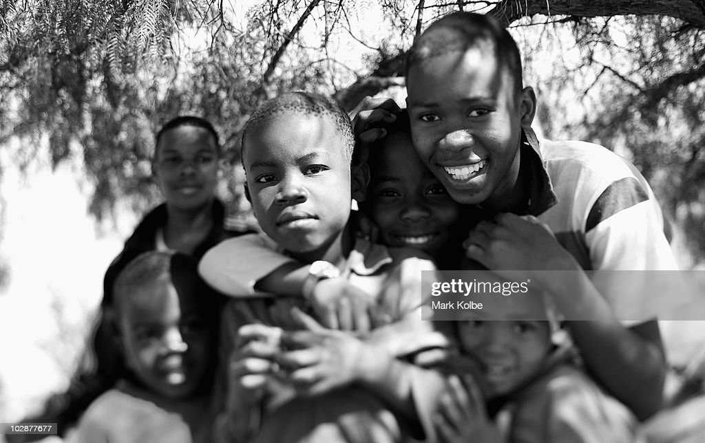 IMAGE. Image has been converted to black and white.) A group of local boys pose on the side of the road on June 24, 2010 in Rustenburg, South Africa.