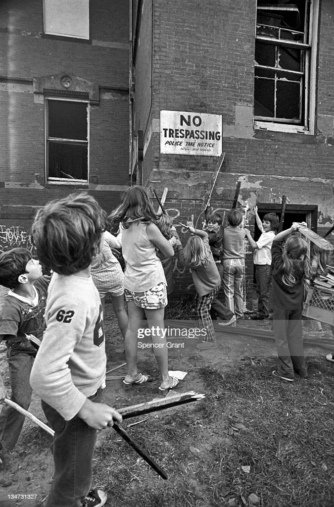 A group of local kids in a South Boston neighborhood trash an abandoned school building during its demolition 1971