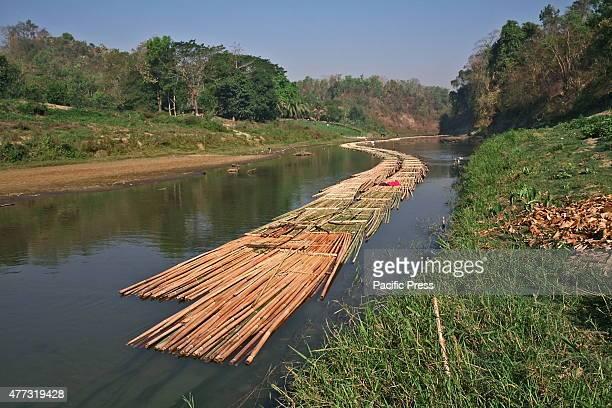 ALIKADAM BANDARBAN BANGLADESH BANDARBAN BANGLADESH A group of local people are bamboo rafting on the Matamuhuri River into the Bandarban hill Bamboo...