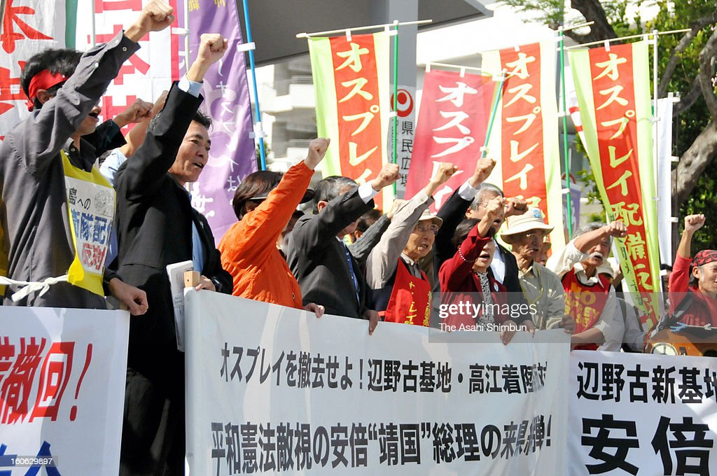 Group of local residents against U.S. military's Osprey deployment and replacement of U.S. Marine Corps Futenma Air Station appeal to Japanese Prime Minister Shinzo Abe on February 2, 2013 in Naha, Okinawa, Japan. Abe visits Okinawa for the first time taking office in December.