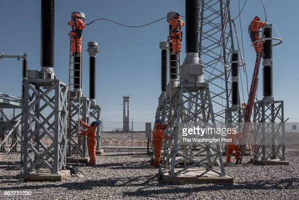 CALAMA CHILE MARCH 9 A group of local workers are cleaning the booster substation of the Cerro Dominador solar plant which raises the voltage to 220...