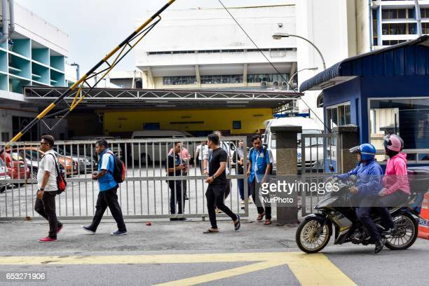 Group of Malaysian pictured at the gate of the forensics wing of the Hospital Kuala Lumpur on March 14 2017 Where the body of Kim JongNam is being...