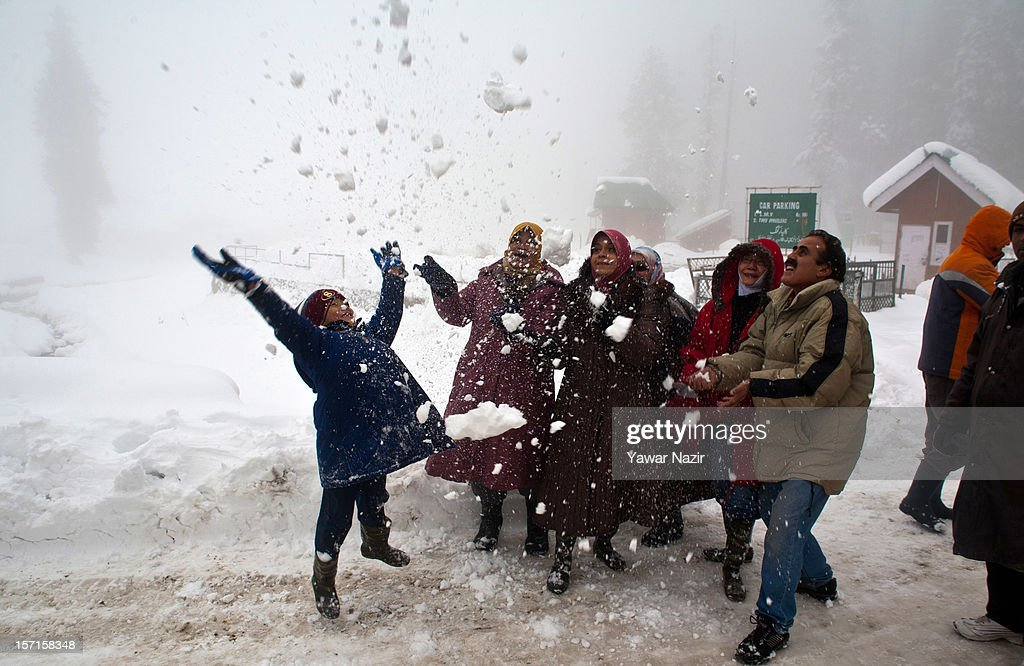 A group of Malaysian tourists play with snow during the season's first snowfall, on November 29, 2012 in Gulmarg, 54 km (35 miles) to the west of Srinagar, the summer capital of Indian-administered Kashmir, India. As the Kashmir valley received heavy snowfall in its upper reaches, the 434-km Srinagar-Leh National highway, the highest motorable road in the world, was closed to traffic. The famous ski resort of Gulmarg also experienced the first heavy snowfall of the season, officials said. Gulmarg, located less than six miles from the ceasefire line or Line of Control (LoC) that divides Kashmir between India and Pakistan, is known for long-run skiing, snow-boarding, heli-skiing and steep mountains.
