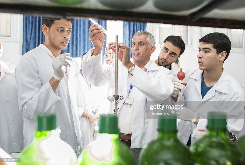 A group of male pharmacology students pictured with their teacher in a laboratory at the Al-Azhar University on November 06, 2013 in Gaza City, The Palestinian Territories.